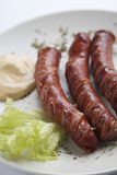 Grilled sausages with mustard Stock Image
