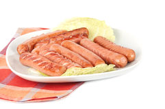Grilled sausages on a plate Stock Photo