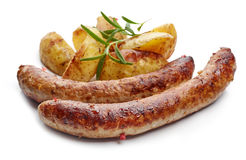 Grilled sausages and potatoes. Isolated on white background royalty free stock photography
