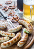 Grilled sausages with pretzels and mugs of beer Stock Photo