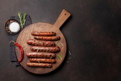 Grilled sausages. With rosemary herbs. Top view with copy space royalty free stock photos