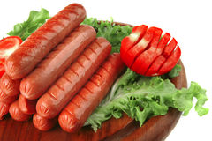 Grilled sausages served on wood Stock Photography