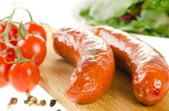 Grilled sausages with side salad Royalty Free Stock Photo