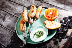 Grilled sausages on skewers, barbecue, charcoal, firewood, still life nuremberg, german, bratwurst, pork, bavaria Royalty Free Stock Photography