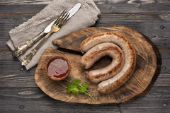 Grilled sausages. With spicy sauce stock photos