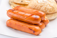 Grilled sausages stack served with the fresh oven breads, health Royalty Free Stock Photos