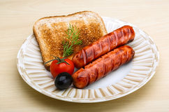 Grilled sausages with toast Stock Photos