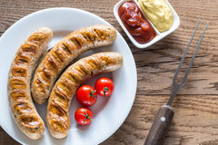 Grilled sausages with tomato and mustard sauce Stock Image