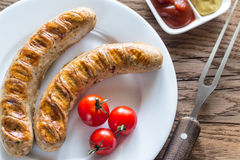 Grilled sausages with tomato and mustard sauce Stock Photos