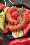 Grilled sausages and vegetable Stock Photos
