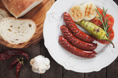 Grilled sausages and vegetable Stock Photo