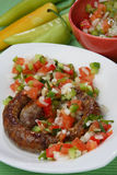 Grilled sausages with vegetable sauce Stock Images