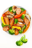 Grilled sausages and vegetables Royalty Free Stock Photos