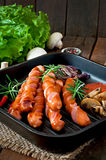 Grilled sausages with vegetables Stock Photos