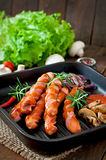 Grilled sausages with vegetables Stock Image