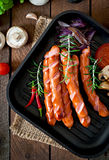 Grilled sausages with vegetables Royalty Free Stock Photos