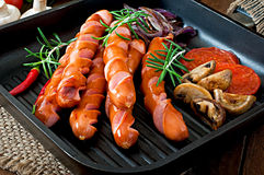 Grilled sausages with vegetables Stock Photography