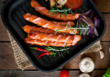 Grilled sausages with vegetables Stock Images