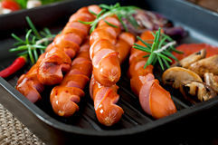 Grilled sausages with vegetables Stock Photo