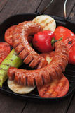 Grilled sausages and vegetables Royalty Free Stock Images