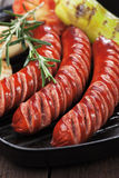 Grilled sausages and vegetables Stock Photography