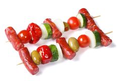Grilled sausages with vegetables on skewers isolated Stock Image