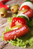 Grilled sausages with vegetables on skewers macro Stock Images