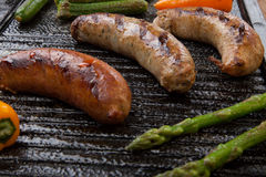 Grilled Sausages and Vegetables Royalty Free Stock Photography