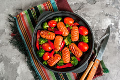 Grilled sausages and vegetables Royalty Free Stock Image