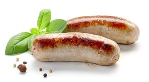 Grilled sausages on white background. Grilled sausages isolated on white background royalty free stock photos