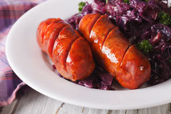 Free Grilled Sausages With A Garnish Of Red Cabbage Close-up. Horizon Royalty Free Stock Photography - 67593067