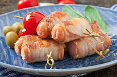 Grilled sausages wrapped in strips of bacon Royalty Free Stock Photography