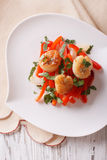 Grilled Scallops with peppers and herbs closeup. Vertical top vi Royalty Free Stock Photography