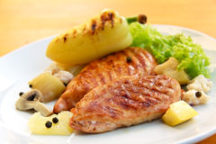 Grilled schnitzel of turkey with vegetables Stock Image
