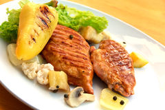 Grilled schnitzel of turkey with vegetables Stock Photo
