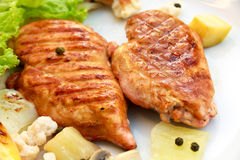 Grilled schnitzel of turkey with vegetables stock images