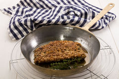 Grilled scottish kipper coated with oatmeal and thyme in a pan Royalty Free Stock Photo