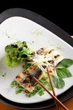 Grilled sea bass fillet with ginger and Pak Choy Royalty Free Stock Image