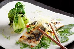 Grilled sea bass fillet with ginger and Pak Choy Stock Photo
