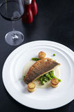 Grilled sea-bass in white sauce Stock Photos