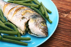 Grilled sea bream fish with green beans Stock Photos