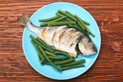 Grilled sea bream fish with green beans Royalty Free Stock Photo