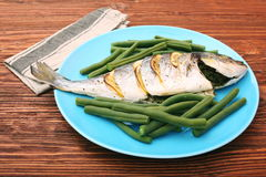 Grilled sea bream fish with green beans Stock Photo