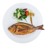 Grilled sea bream fish with vegetables. Isolated on white background. Clipping path Stock Photography