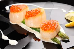 Grilled sea scallops with asparagus royalty free stock photography