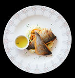 Grilled seabass fillet in plate, isolated on black Royalty Free Stock Image