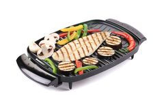 Grilled seabass on grill with vegetables. Stock Photography