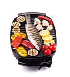 Grilled seabass on grill with vegetables. Royalty Free Stock Images