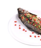 Grilled seabass on a plate. Royalty Free Stock Images
