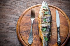 Grilled seabass on the wooden board Royalty Free Stock Photo
